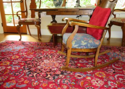 rocking chairs accentuated by large Persian rug