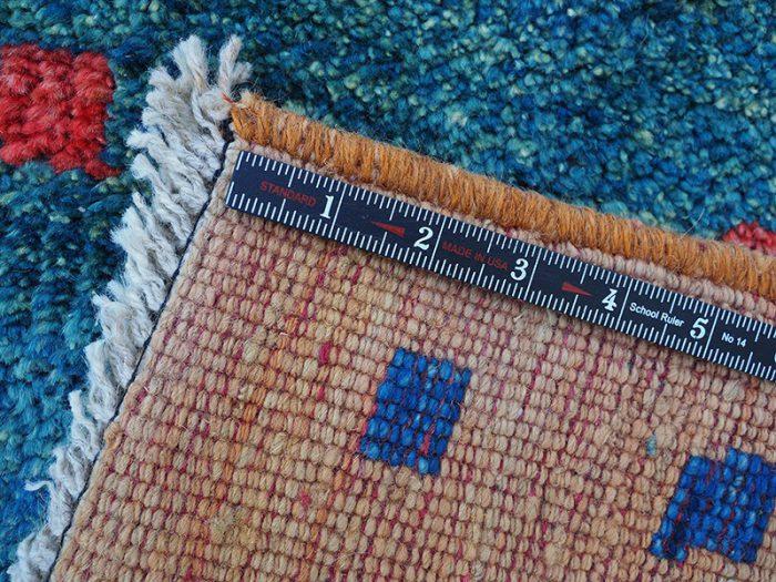 Hand woven wool area rug